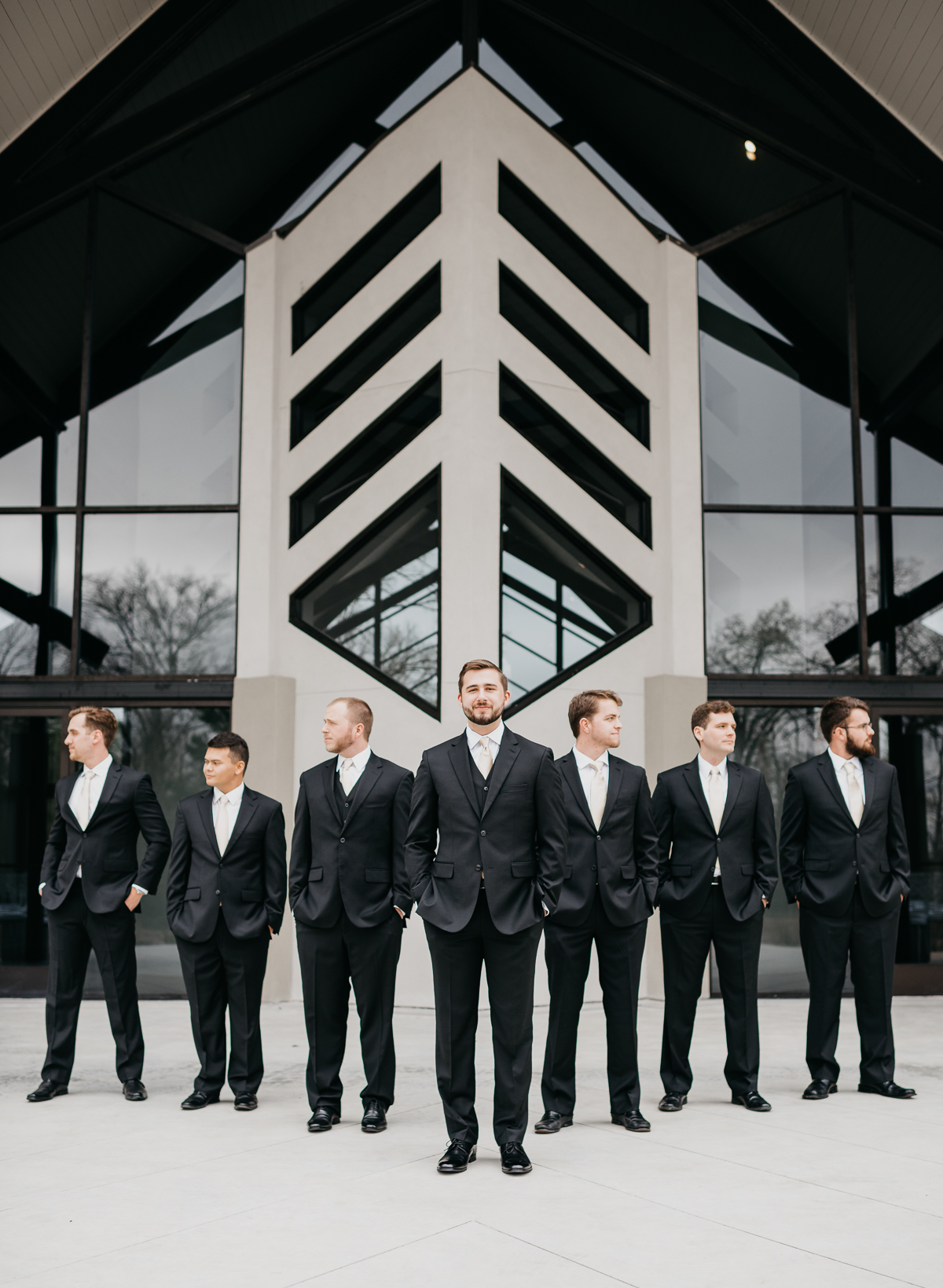 Modern elegant carefree nature wedding at Jennings Trace wedding venue in Conroe Texas camera shi photography groomsmen